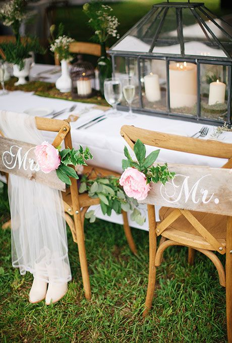 "Brides.com: . A crafty bride and groom created their ""Mr. and Mrs."" chair signs out of recycled apple crates from the farm where they held their wedding."