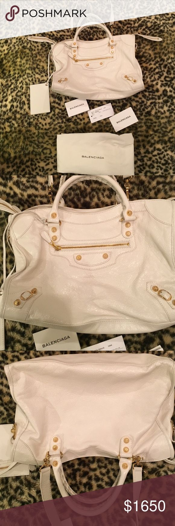 """White classic city balenciaga Balenciaga """"Classic City"""" bag white with metal-edged golden hardware,  Hand-stitched top handles, 4"""" drop. Removable shoulder strap, 8"""" drop. Extended zip top closure. Exterior front zip pocket. Cotton-lined interior; one zip and two slip pockets. Removable hanging leather-frame hand mirror. 9.4""""H x 14.8""""W x 5.5""""D; weighs 1 lb. 11.8 oz. Made in Italy. Balenciaga Bags Shoulder Bags"""