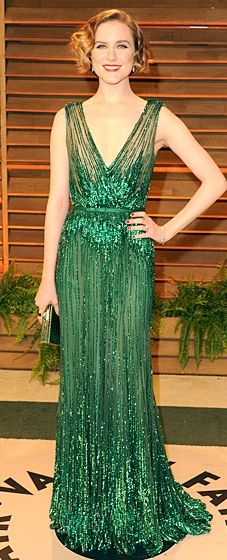 Evan Rachel Wood wearing a green sequined Elie Saab gown with a short, retro hairdo at the 2014 Vanity Fair Oscar Party