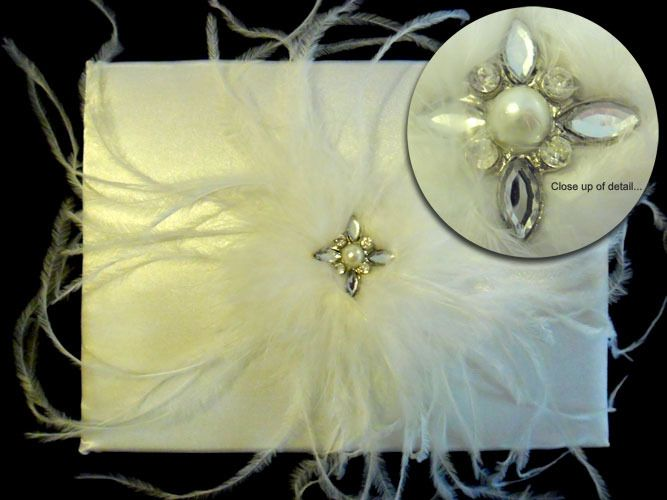Guestbook Feathers and Rhinestones http://www.aussieweddingshop.com.au/Product/44/guestbook-feathers-and-rhinestones