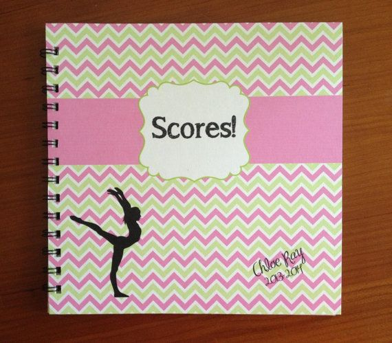 Custom made score book for gymnastics meets.  Has meet sheets, calendars, places for photos and journaling, about me, and meet information.