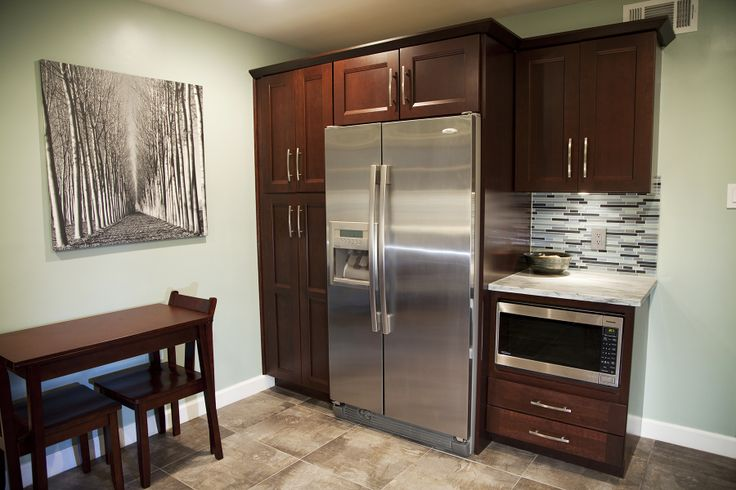Cherry wood cabinets, Stainless steel refrigerator and Wood cabinets