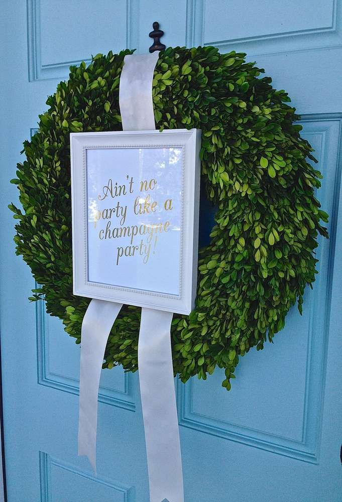 Gold & champagne birthday party welcome wreath! See more party planning ideas at CatchMyParty.com!