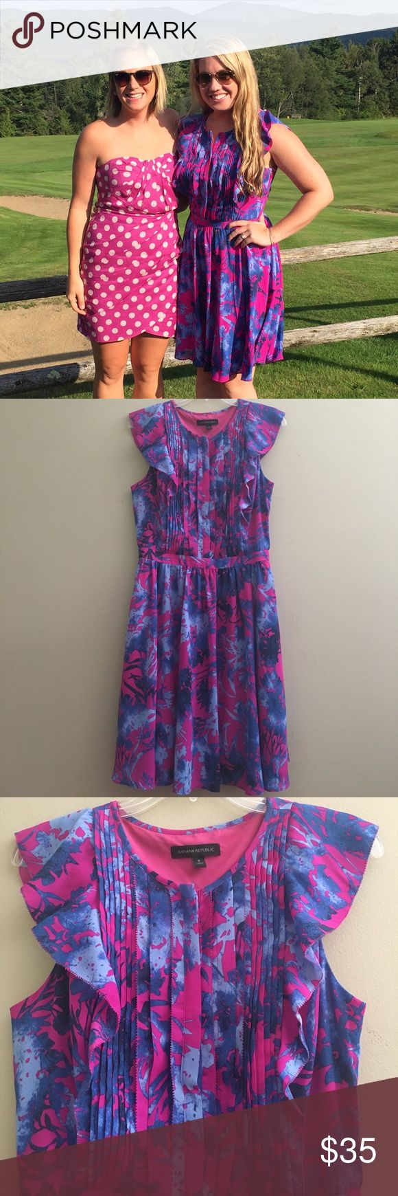 Banana Republic dress with pockets!!! Pink and blue dress with pin tuck pleating on chest with ruffles down side. 4 buttons down front of chest. Has pockets!! Worn once to a wedding. Banana Republic Dresses