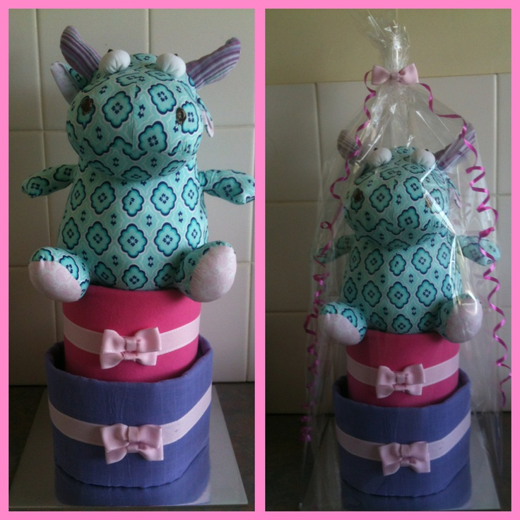 Two tiered girls cake with toy cow