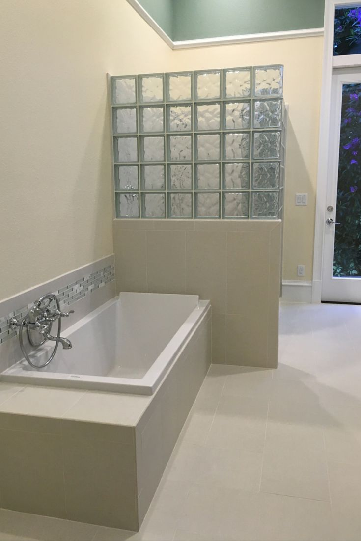 Learn How This Glass Block Shower Wall Was Prefabricated