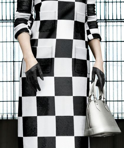 Woman in checkered dress