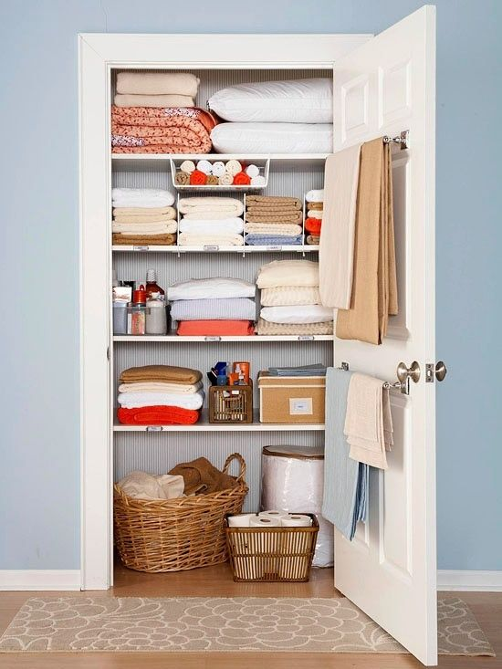 Use a towel rod on the inside of the linen closet for holding blankets. (this is a good idea for back of guest room door too so if guests need extra blankets, they are easy to find)