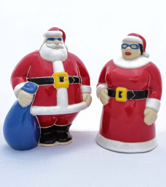 Mr. & Mrs. Santa Clause. They are handmade and hand-painted in South Africa.