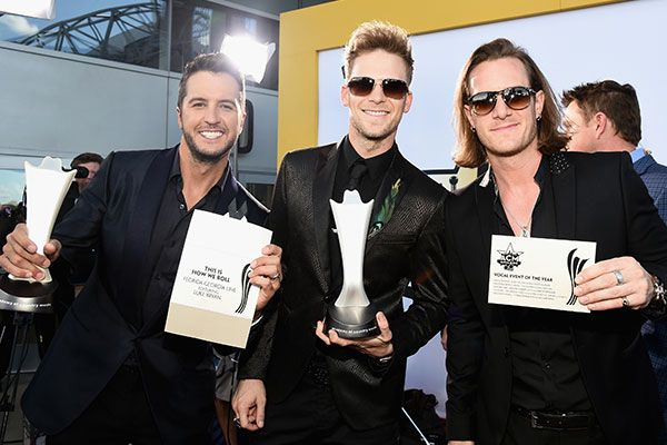 Luke Bryan (left) and Florida Georgia Line win vocal event of the year at the 50th annual ACM Awards in Arlington, Texas, on April 19, 2015.