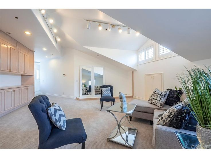 Granite Columns Define The Enormous Living Room With Vaulted Ceilings,  Granite Floors And Custom Fireplace