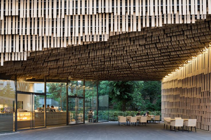 kengo kuma clads campus building with layered timber slats