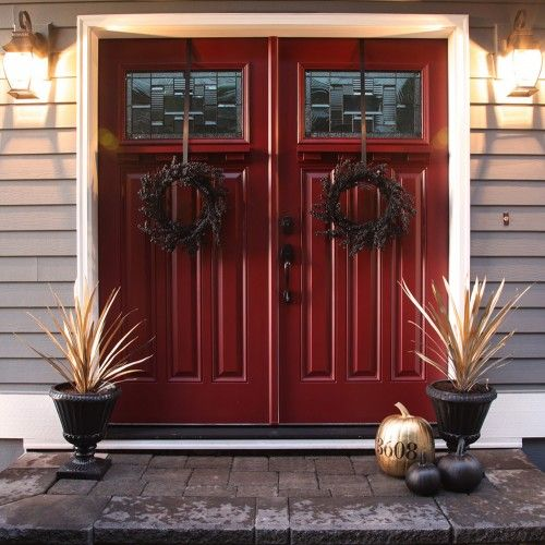 For Fall, add a few small elements: painted pumpkins and door wreaths. Add your house number to the pumpkins for a personal touch!