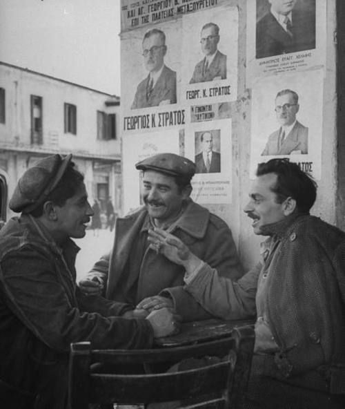 Group of men discussing upcoming elections, Greece, 1946