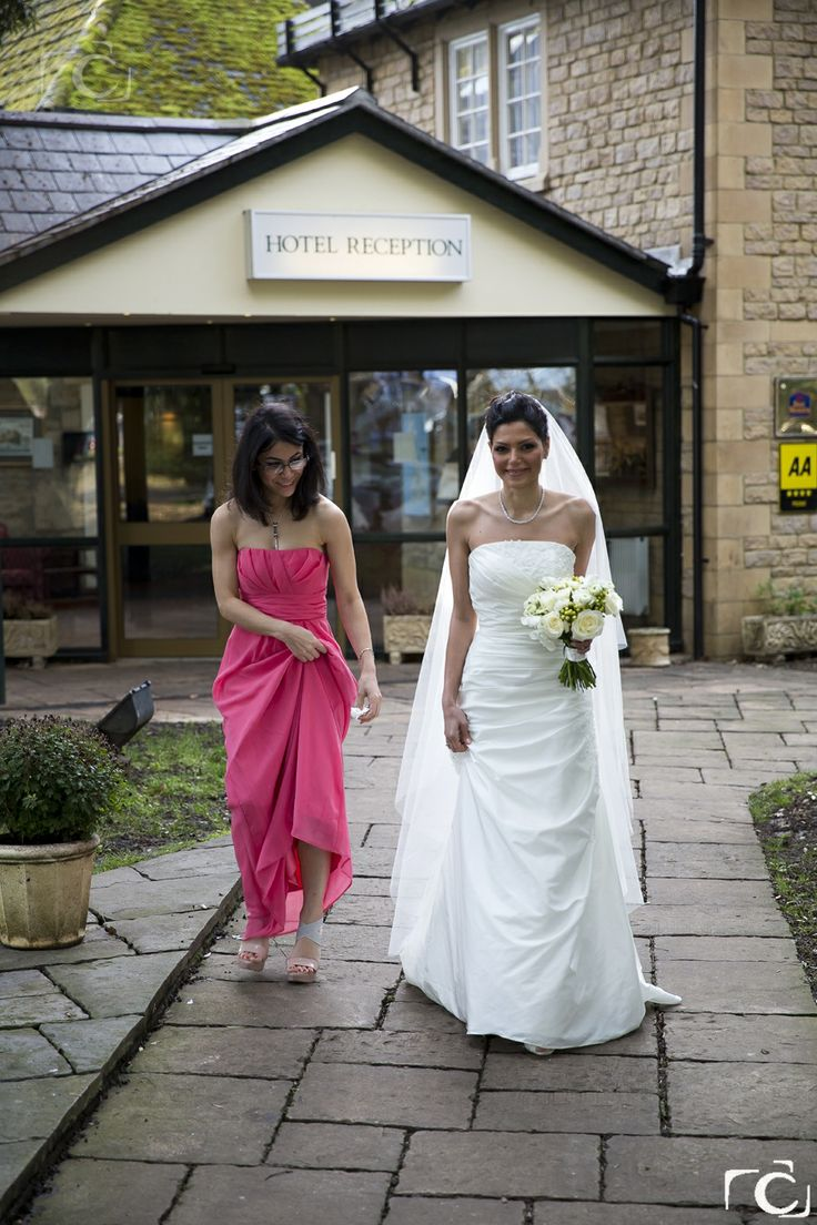 Bride and bridesmaid on the way to the Peterborough Registry Office.