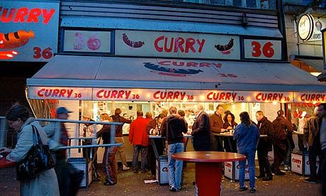 """Curry 36 If you want to eat currywurst the Berlin way, order yours here boiled and naked (""""ohne darm"""", without skin), looking a little pale in comparison with the ones in pink skins. The sausage at this particular snack bar is popular. Besides the currywurst there's bockwurst, krakauers and several other types of sausage as well as proletarian Berlin specialities such as fried burgers and bouletten (meatballs). Mehringdamm 36, Kreuzberg 9am-5pm. Currywurst €2.50"""