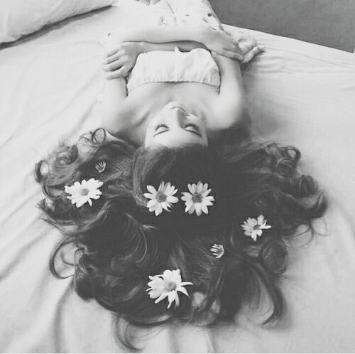A girl with flowers in her hair