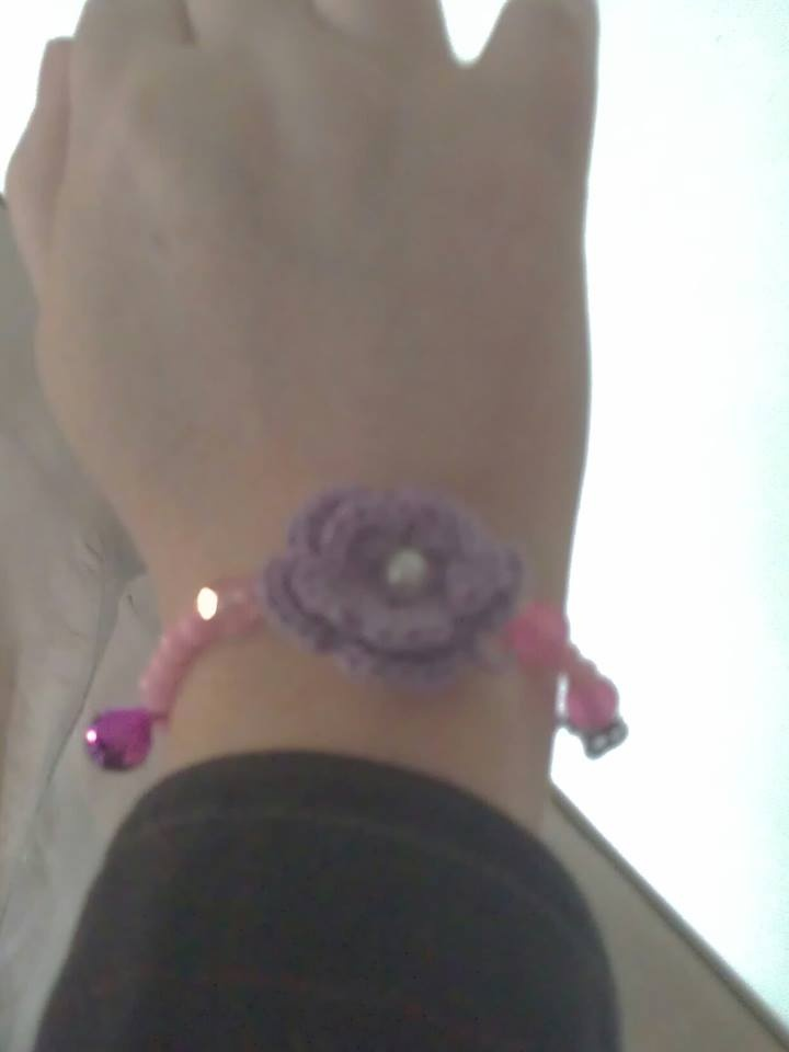 Tinkle .. (with an little bell) and an flower some beads