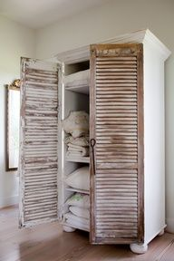 Shining Shutters: To give an old bookcase a touch of cottage style, attach two shutters to use as doors. Don't worry about painting them; a little patina adds to the charm.