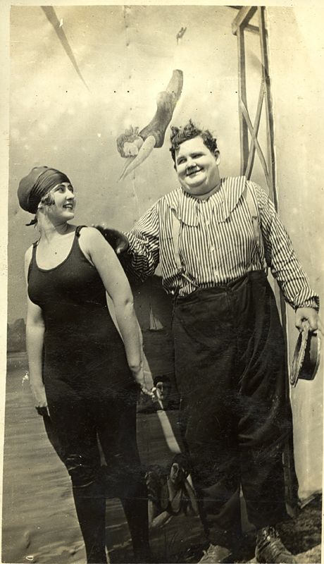 """Ollie Hardy in """"The Heroes,"""" 1916, clowning with Rae Godfrey."""
