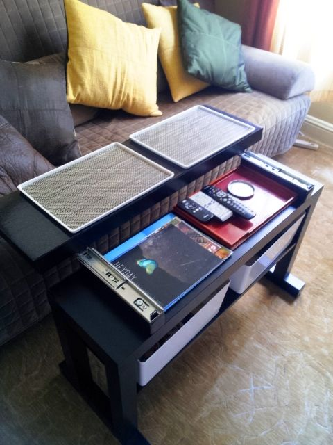 Gliding top cantilever LACK coffee table with bin lids that convert to TV trays | IKEA Hackers