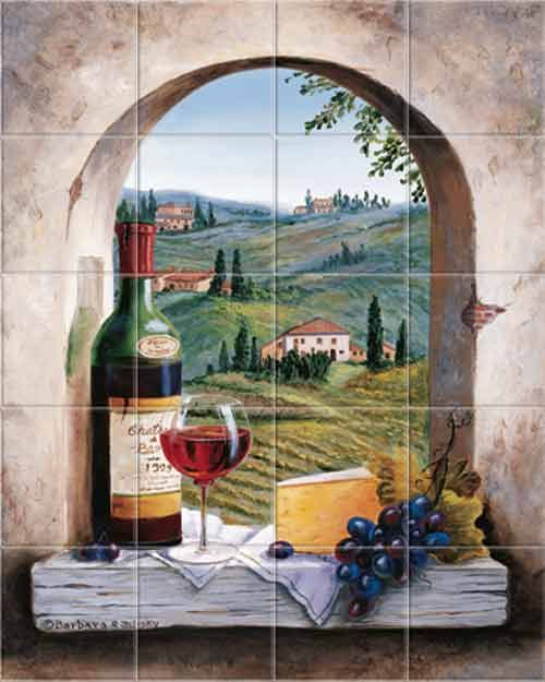 Tuscany mural shows a vineyard, farmhouses, countryside, cypress trees, old world stone arch window. A red wine bottle, glass, wedge of cheese, purple grapes set atop a wooden ledge. from the Barbara R. Felisky Signature Line of Kitchen Tile Backsplashes and Accent Tiles