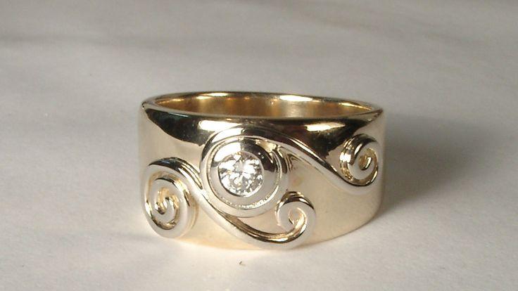 Maori influenced diamond ring design for her.