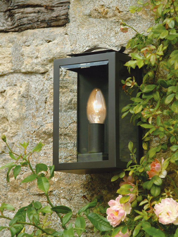 Crafted from powder coates steel in a soft mole colour, this glass fronted lantern is inspired by traditional railway lanterns. Weather resistent, it looks wonderful mounted on an outside wall or fence, or in a cosy alcove. Click here to view our useful lighting guide.