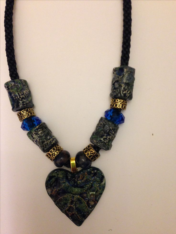 Clay impressed heart with sapphire gem beads, gold metal and clay beads