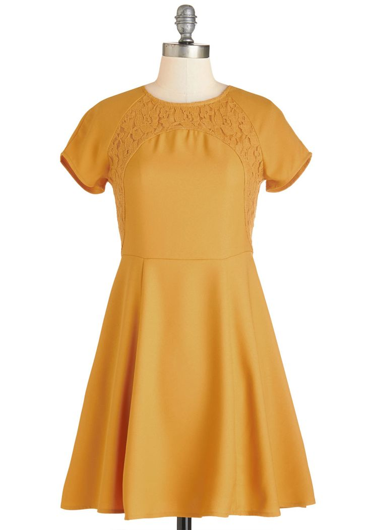 Marigold Rush Dress. While you couldnt wait to get into the sweet silhouette of this marigold-yellow dress, now that youre sporting its short sleeves and A-line skirt, you feel like taking a more leisurely pace. #yellow #modcloth
