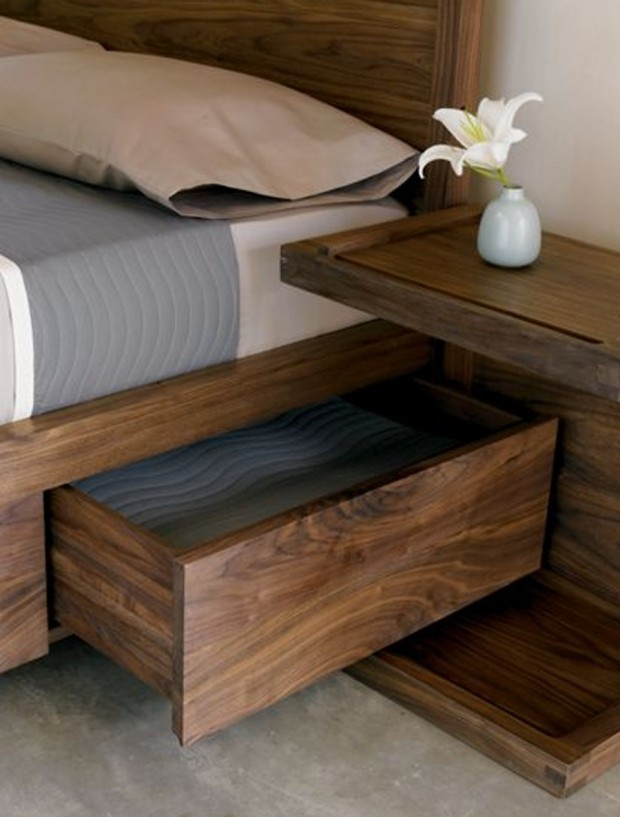 Storage bed with interesting way to accommodate a bedside table