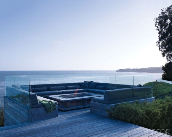 At actress Courteney Cox's Malibu home, a custom-made banquette surrounds a teak-and-steel lava-rock fire pit.