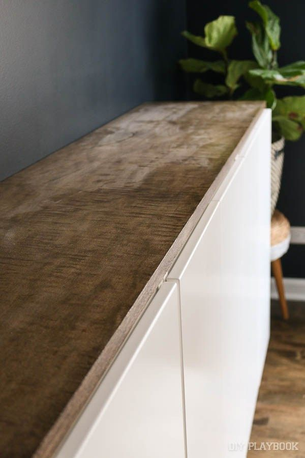 We needed some storage in our guest room, so we built a floating credenza. Here's how to build a fauxdenza with a step-by-step tutorial!
