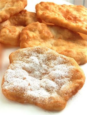 """County Fair Fried Dough -  2 c Flour 2 tsp baking powder 3/4 tsp salt 2 tbs cubed cold unsalted butter 3/4 c warm water  Mix dry, cut in butter, add water to form dough. Rest 15 min. Divide in 8, roll out 3/8"""", fry in 375*F oil until bubbly, flip and brown other side. Serve warm, with pdr sugar or honey."""