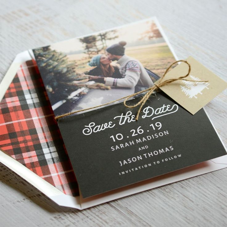 An elegant expression of your love for rustic style, these beautiful holiday card save the dates feature your photo on the front above your message and a red plaid pattern covering the back. The card is finished with a kraft-colored accent tag featuring towering pines, which is secured to the card with natural twine.