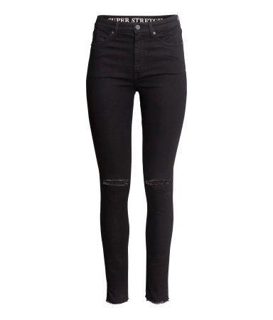 Svart. Ett par jeans i stretchig, tvättad denim med extra smala ben och hög…