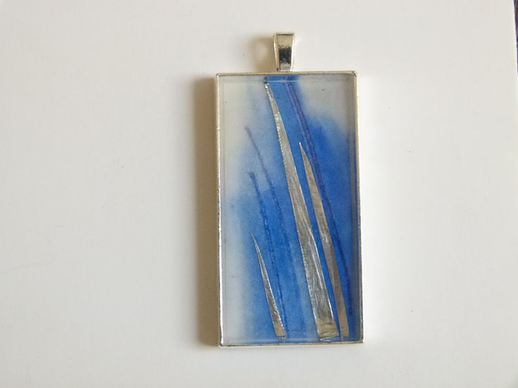 """Silver Reeds"" memories of lake reeds, shining in the light, captured with watercolours and silver foil, for ever, under a resin cap, set in a silverplated bezel.  See more at jackiesimmondsStudio on Etsy"