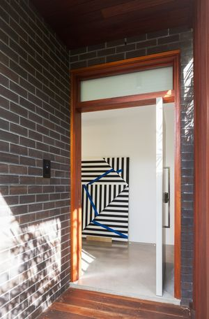Entry with black angus brick at the Naremburn House by Bijl Architecture in Sydney