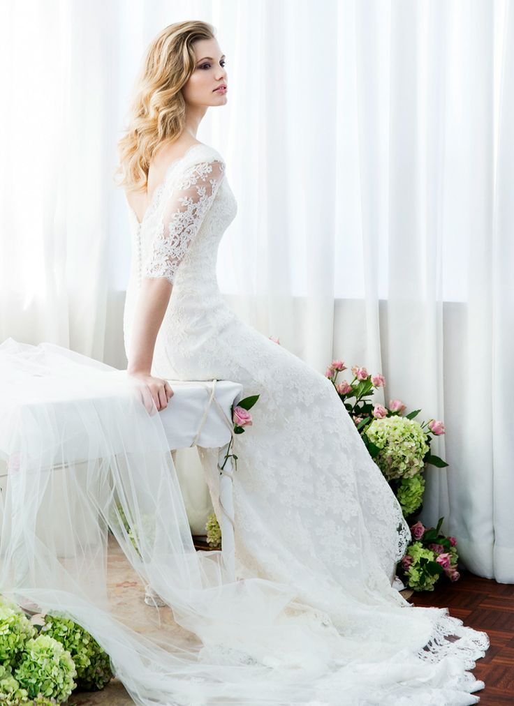 #Beautiful laceweddingdress with #sheerlacesleeve. This #AnnaSchimmel #designergown stands for #simplestyling, #greatcut and #luxuriousbridalfabrics. A #feminineweddingdress to frame #everybrides' #naturalbeauty. #CordedFrenchlace on #ivorysilksatin, #slendercut with #sheerlacesleeves. This #bridalgown has a #smalllacetrain, #ellbowlengthsleeves and #buttonedback. View #weddingdress in our #bridalcollection, #weddingdressphotos…