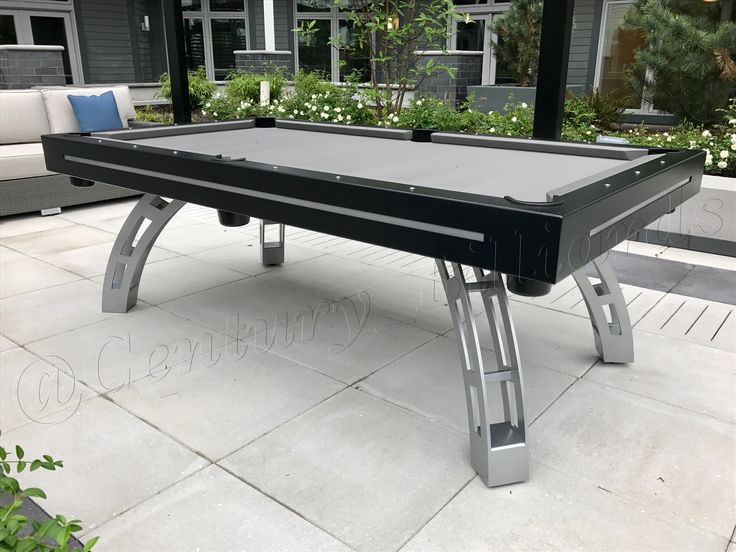 Custom outdoor pool table design with a modern flare.  This table is 100% waterproof and is available in both regulation 7' & 8' sizes.  Made of solid aluminum and stainless steel, our seamless construction is a beautiful piece of furniture.
