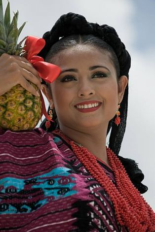 A dancer from Santa Maria Asuncion Tlaxiaco performs during the Guelaguetza celebration on July 27, 2009 in Oaxaca, Mexico. The Guelaguetza is a festival held once a year which gathers music, dances, gastronomy and handicrafts of different ethnic groups and tribes of the state of Oaxaca. AFP PHOTO/Omar Torres (Photo credit should read OMAR TORRES/AFP/Getty Images) Photo: Omar Torres, AFP/Getty Images / SF