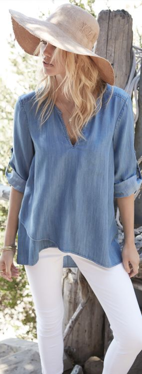 Roll-tab sleeves and a flattering asymmetric hem give signature style to this favorite top. Soft #chambray is perfect year-round, which means this style won't go out of style any time soon.