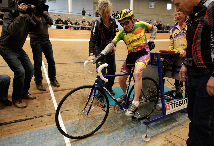 100-year-old cyclist Robert Marchand of France gets on his bike to set a world record for cycling non-stop for one hour at the Union Cycliste Internationale (UCI) velodrome in Aigle, Switzerland on February 17, 2012. Marchand, born November 26, 1911, cycled 24.251 km (15 miles) around the 200 meter indoor track to set the record. (Denis Balibouse/Reuters)