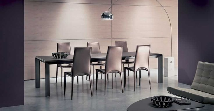 METRO', design: Toshiyuki Yoshino/Studio Ozeta - Aluminum frame dining table, telescopic mechanism extending frame, glass top and inside sliding glass extension. www.ozzio.com