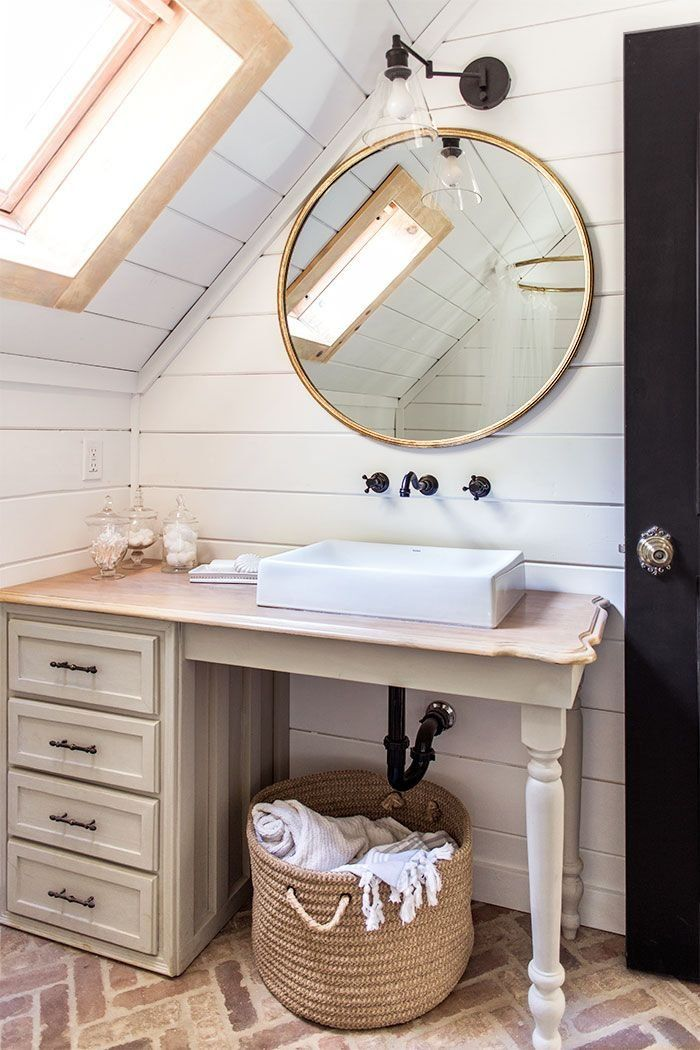 In her complete cottage makeover, Jenna Sue designed a bathroom filled with charming details. It's all the shiplap and exposed brick you've been dreaming of.