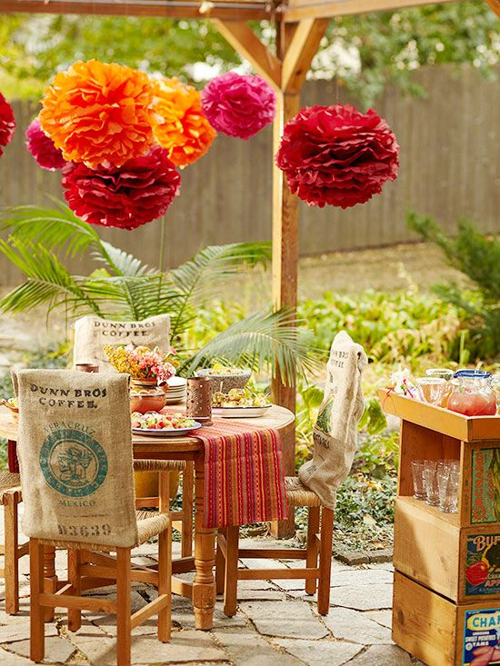 A Spanish-style table and chairs add warmth to this small patio! See more casual porch and patio dining ideas here: http://www.bhg.com/home-improvement/porch/outdoor-rooms/casual-porch-dining/?socsrc=bhgpin042515spanishflairporch&page=11