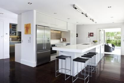 """A renovated kitchen featuring a Hideaway Bin. With open-plan spaces more often than not providing for the social needs of the family and their guests, it makes sense to ensure they are both functional and accessible. """"The resulting balanced effect between spaces imparts a warm ambience throughout, creating a comfortable inviting atmosphere,"""" says Du Bois."""