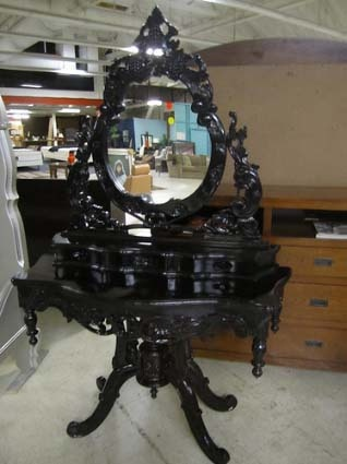 4116 ORNATE GLOSS BAROQUE VANITY  Make yourself beautiful in front of this fabulous French provincial style dressing table and mirror! This incredibly detailed and beautiful Rococo vanity is adorned with four brilliantly carved legs and drawers as well as a beautifully made mirror. It is an incredibly stylish and stunning addition to your boudoir.    Shown here, it is finished in black lacquer paint. However, we can custom paint it any color for you!   16 (depth), 43 (width), 73 (height)