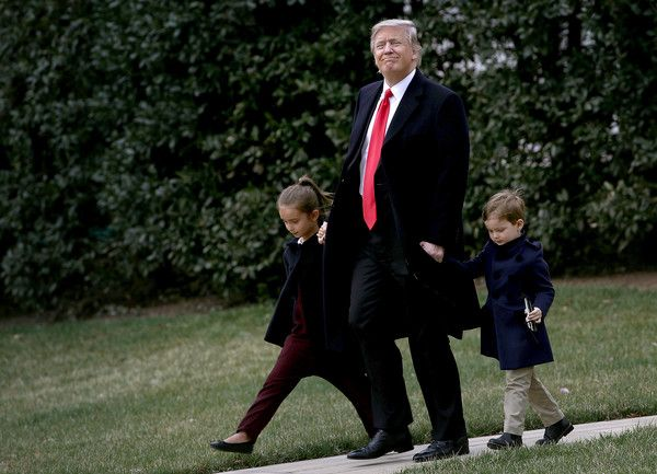 Donald Trump Photos Photos - U.S. President Donald Trump departs the White House with his grandchildren Arabella (L) and Joseph (R) on March 3, 2017 in Washington, DC. Trump was scheduled to fly to Florida where he will spend the weekend. - President Trump Departs White House For Florida