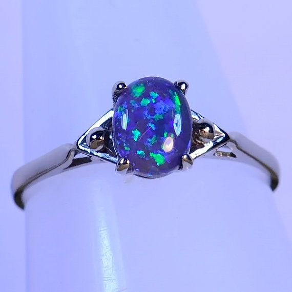 THIS is probably the single most beautiful ring I have ever seen. I'm completely in love with it. Australian opals are my FAVORITE.   Black Opal from Lightning Ridge Australia in 18ct by justopal